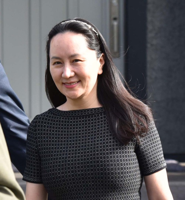 Huawei Chief Financial Officer, Meng Wanzhou, leaves her residence to attend British Columbia Supreme Court, in Vancouver, on May 8, 2019. [Photo: AFP]