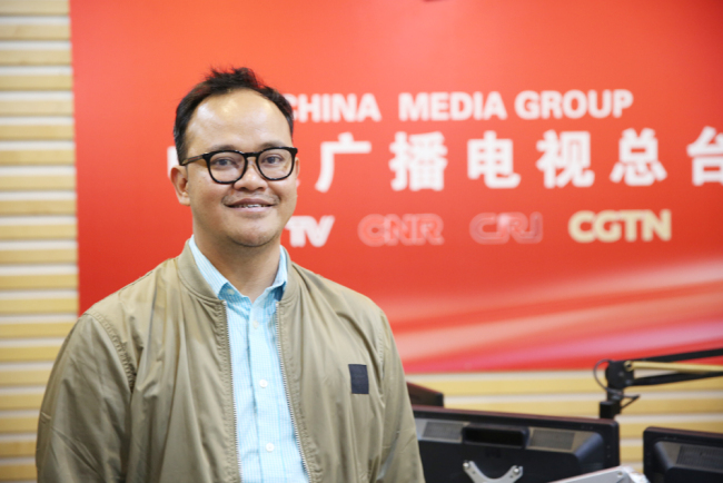 Gandhi Priambodo takes in interview from China Plus on April 17, 2019. [Photo: China Plus]