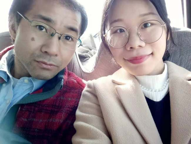 Mori Masatsugu (L) poses for a selfie with his wife, a Beijing local, on March 7, 2019. [File Photo provided for China Plus]