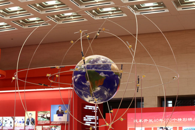 A model of the Beidou Navigation Satellite System is on display during an exhibition for the 40th anniversary of China's reforms and opening-up in Beijing, China, 14 December 2018. [Photo: IC]