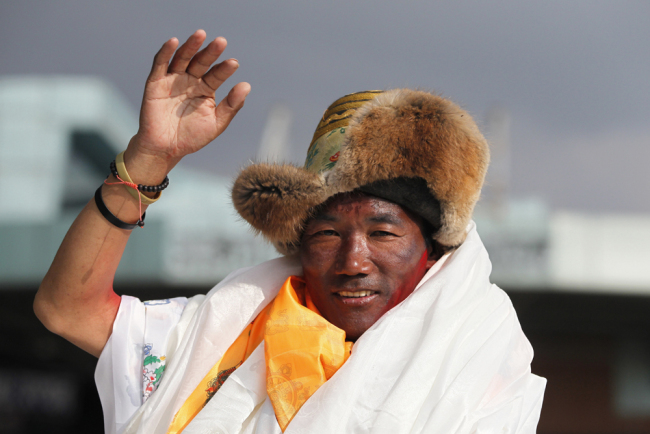 In this May 20, 2018, file photo, Nepalese veteran Sherpa guide, Kami Rita, waves as he arrives in Kathmandu, Nepal. Rita has scaled Mount Everest for a 23rd time, breaking his own record for the most successful ascents of the world's highest peak. [File Photo: AP]