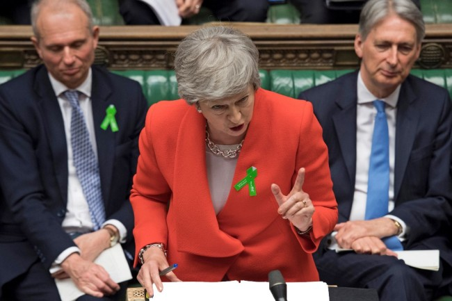 Britain's Prime Minister Theresa May speaking (C), during the weekly Prime Minister's Questions (PMQs) question and answer session in the House of Commons in London. [Photo: AFP/UK Parliament]