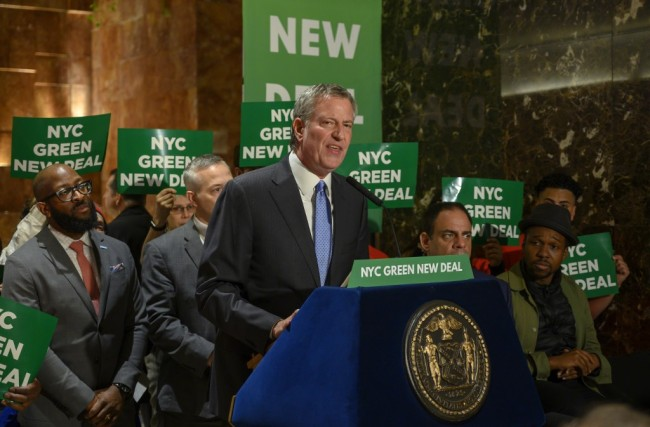 New York City Mayor Bill de Blasio speaks inside Trump Tower about the Green New Deal, serving notice to US President Donald Trump demanding more energy-efficient buildings, including Trump Tower, May 13, 2019 in New York. [Photo: AFP/Don Emmert]