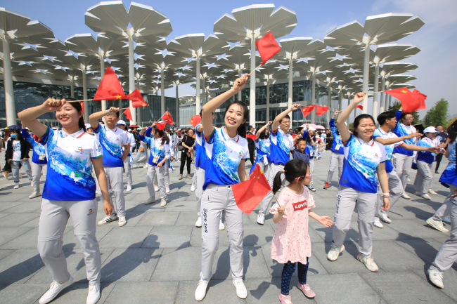 Visitors perform outside the International Pavilion at the Beijing horticultural expo site, in Yanqing District, northwest Beijing, on May 3, 2019. [File Photo: IC]