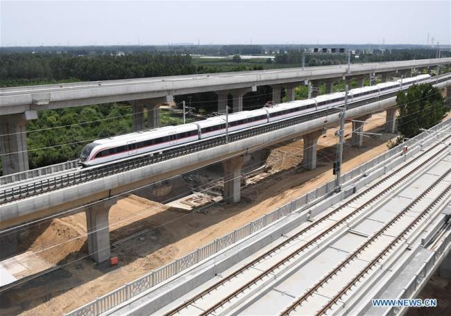 A train runs on a new airport subway line for trial in Beijing, capital of China, June 15, 2019. [Photo: Xinhua]