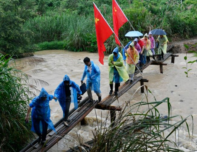 A group of people retracing the route of the Long March visited the river in Yudu County, Jiangxi Province on June 13, 2019. [Photo: IC]