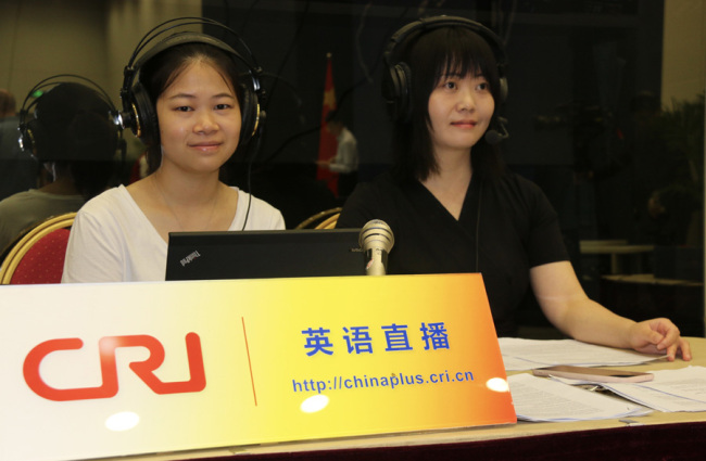 China Plus host Zhou Fang (right) at the news conference hall at China's Ministry of Foreign Affairs [Photo: China Plus]