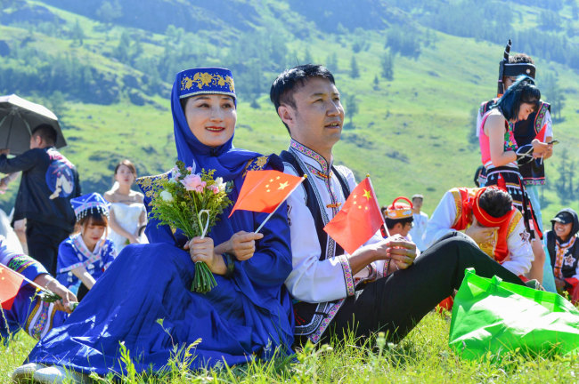 People attend a group wedding at the Kanas scenic area in Aletai, northwest China's Xinjiang Uygur Autonomous Region, July 1, 2019. [Photo: IC]