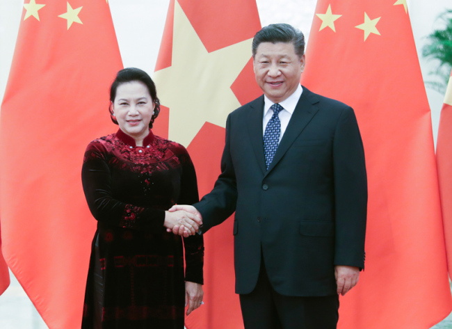 Chinese President Xi Jinping (R) meets with visiting Chairwoman of the National Assembly of Vietnam Nguyen Thi Kim Ngan in Beijing on Friday, July 12, 2019. [Photo: Xinhua]
