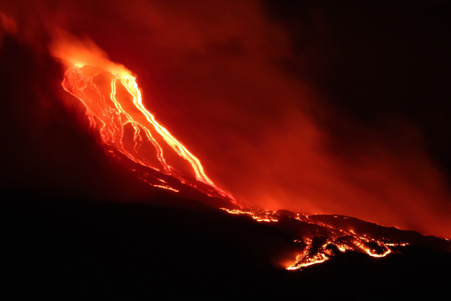 Mt. Etna continues the lively Strombolian activity of the New South East Crater, which has generated a long lava flow, which flows from the valley of the Bove, on the east coast of Sicily, Italy, on Saturday, July 20, 2019. [Photo: IC]