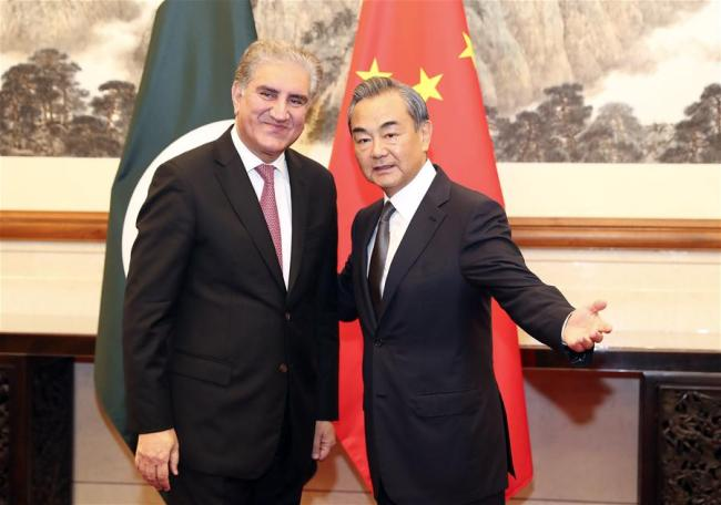 Chinese State Councilor and Foreign Minister Wang Yi (R) holds talks with Pakistani Foreign Minister Shah Mahmood Qureshi in Beijing, capital of China, Aug. 9, 2019. Qureshi is in China on a special and emergency visit. [Photo: Xinhua/Ding Lin]