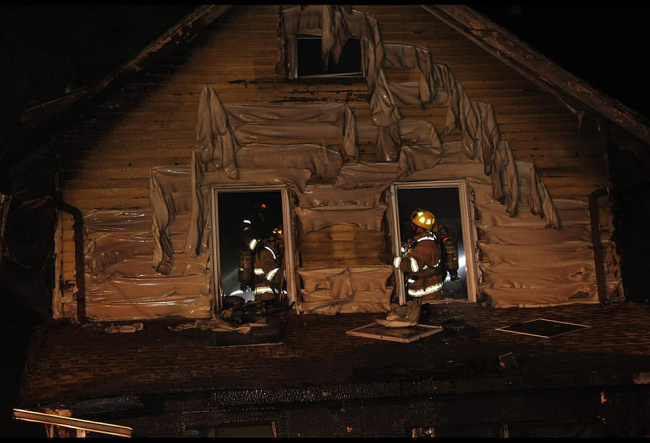 In this photo released by the Erie Fire department, firefighters work to put out a house fire in Erie, Pennsylvania early in the morning on August 11, 2019. [Photo: Erie Fire Department/AFP via VCG]