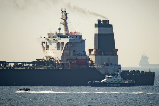 Royal Marine patrol vessel is seen beside the Grace 1 super tanker in the British territory of Gibraltar, July 4, 2019. [File Photo: AP via IC/Marcos Moreno]