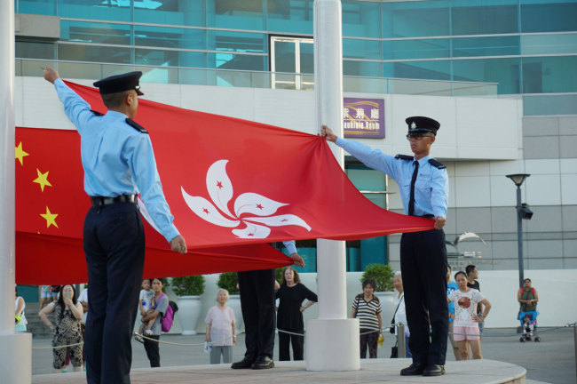 Flags of China and Hong Kong Special Administrative Region of the People's Republic of China are seen during a flag-raising ceremony in Hong Kong. [File photo: IC]