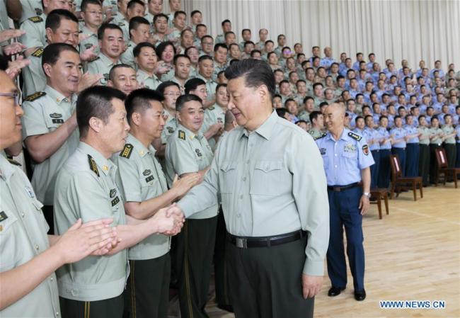 Chinese President Xi Jinping, also general secretary of the Communist Party of China Central Committee and chairman of the Central Military Commission, shakes hands with military officials when inspecting an air force base in Gansu Province on August 22, 2019. [Photo: Xinhua/Li Gang]