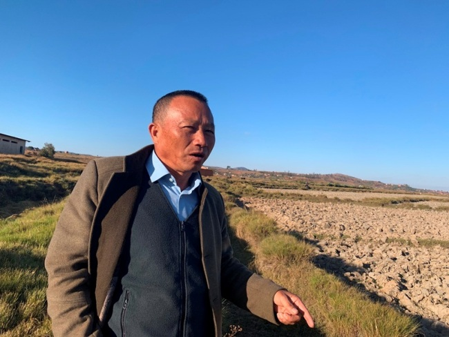 Agricultural expert Hu Yuefang with Yuan's International Agricultural Development Co., Ltd. works to promote hybrid rice in Madagascar for over ten years. [Photo: China Plus/Gao Junya]