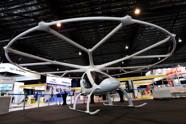"A ""flying taxi"" Volocopter 2X is displayed during a media preview at Rotorcraft and Unmanned Systems exhibition in Singapore on April 8, 2019. [Photo: AFP/Roslan Rahman]"