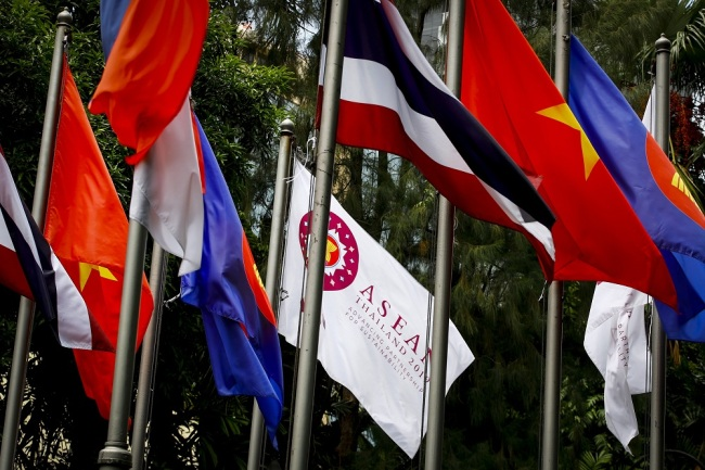 National flags from ASEAN member countries fly next to the ASEAN flag outside the venue for the 34th ASEAN Summit in Bangkok, Thailand, June 19, 2019. [File Photo: EPA via IC/DIEGO AZUBEL]