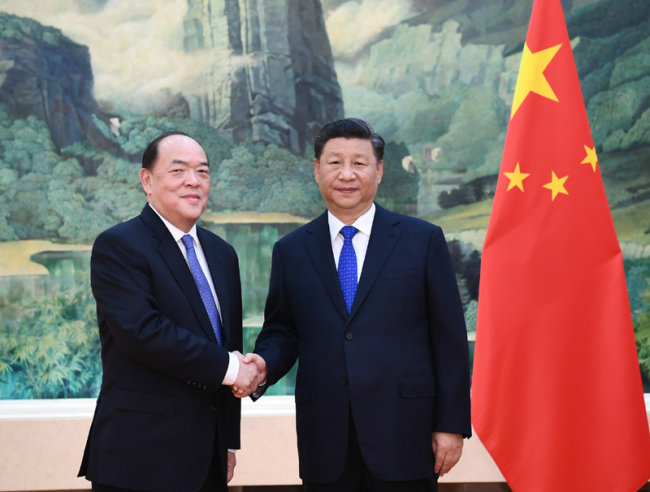 President Xi Jinping (right) meets with Ho Iat Seng, the newly elected and appointed chief executive of the Macao Special Administrative Region at the Great Hall of the People in Beijing on September 11, 2019. [Photo: Xinhua]