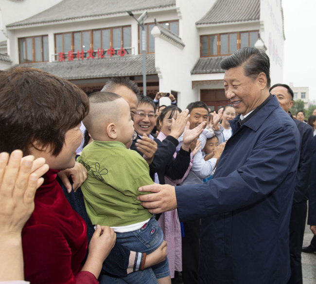 Xi Jinping, general secretary of the Communist Party of China Central Committee, talks with locals at a village in Guangshan county, Henan province on Tuesday, September 17, 2019. [Photo: Xinhua]