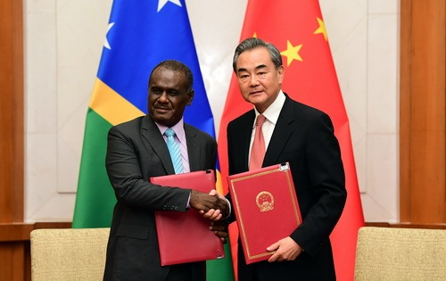 Chinese State Councilor and Foreign Minister Wang Yi (R) and Solomon Islands' Minister of Foreign Affairs and External Trade Jeremiah Manele sign a joint communique on the establishment of diplomatic relations after their talks in Beijing, on Saturday, September 21, 2019. [Photo: fmprc.gov.cn]