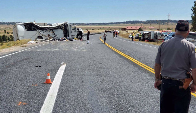 This image released on the Utah Highway Patrol tweeter feed shows a bus transporting Chinese tourists after it crashed on September 20, 2019, near Bryce Canyon National Park. [Photo: @UTHighwayPatrol / AFP]