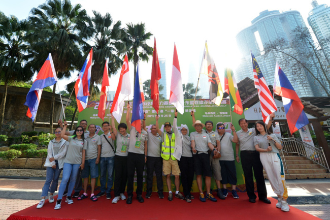 Drivers pose for photos as the competition of the China-ASEAN International Touring Assembly ends in Johor Bahru, Malaysia on Sep 25, 2019. [Photo provided to China Plus]