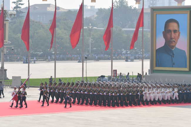 A national flag-raising ceremony is held during a grand rally on October 1, 2019, at Tian'anmen Square in downtown Beijing to celebrate the 70th anniversary of the founding of the People's Republic of China (PRC). [Photo: IC]