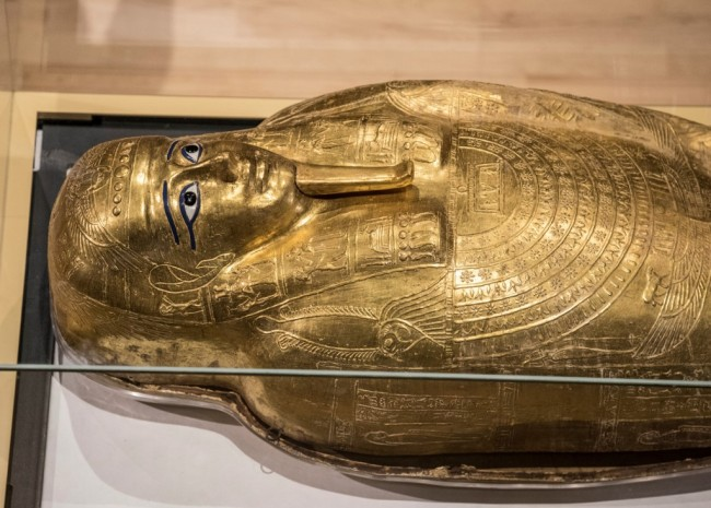 A picture taken on October 1, 2019, shows the Golden Coffin of Nedjemankh, on display at the National Museum of Egyptian Civilization in Cairo, following its repatriation from the US. [Photo: AFP/Khaled Desoukl]
