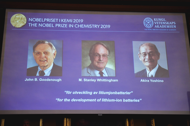 "A screen displays the laureates of the 2019 Nobel Prize in Chemistry, from left, John B. Goodenough, M. Stanley Whittingham, and Akira Yoshino ""for the development of lithium-ion batteries"", during a news conference at the Royal Swedish Academy of Sciences in Stockholm, Sweden, Wednesday Oct. 9, 2019. [Photo: TT via AP/Naina Helen Jama]"