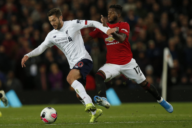 Adam Lallana of Liverpool and Fred of Manchester United during the Premier League match at Old Trafford, Manchester on October 20, 2019. [Photo: IC]