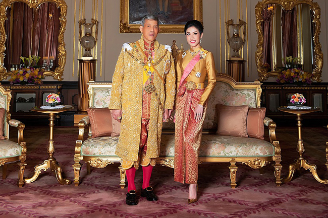 In this file undated handout from Thailand's Royal Office received on August 26, 2019, Thailand's King Maha Vajiralongkorn poses with royal noble consort Sineenat Bilaskalayani, also known as Sineenat Wongvajirapakdi. Thailand's King Maha Vajiralongkorn has stripped his 34-year-old consort of all titles, the palace announced October 21, a shock move less than three months after she was bestowed with a position that had not been used for nearly a century.[Photo: AFP/THAILAND'S ROYAL OFFICE]