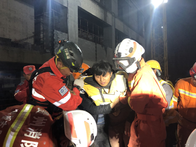Firefighters found a buried person at the collapsed parking lot in Guiyang city, south-west China's Guizhou province, October 29, 2019. [Photo: IC]