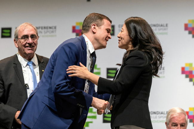 Witold Banka greets Yang Yang during the Fifth World Conference on Doping in Sport WADA2019 in Katowice, Poland, November 5, 2019. [Photo: VCG]