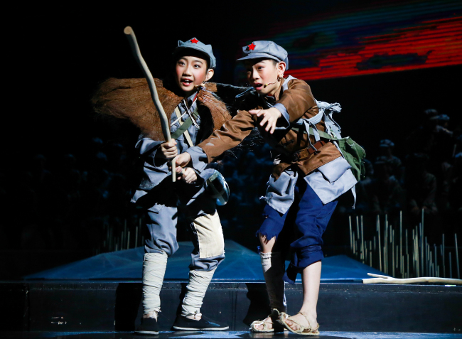 Students in military uniforms perform at the China National Theatre for Children on Nov 21, 2019. Their performance marks the opening of a series of shows that display the accomplishments of drama students in Beijing schools. [Photo provided to China Plus]
