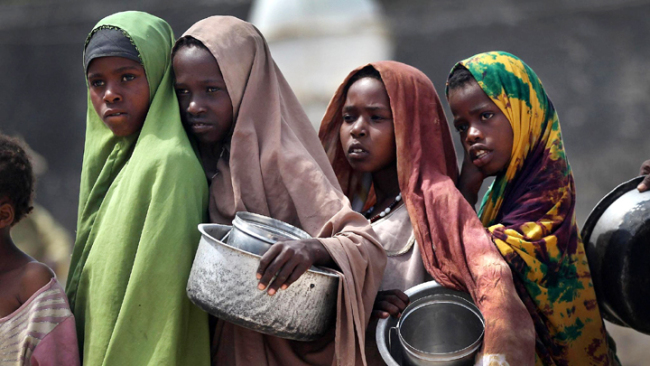 Girls stand in line for food aid on August 14, 2011 in Mogadishu, Somalia. [File Photo: Getty Images via VCG/John Moore]