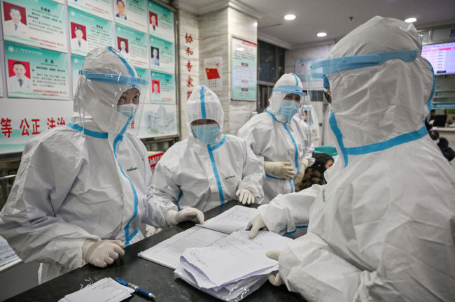 Medical staff members wearing protective clothing work at the Wuhan Red Cross Hospital in Wuhan on January 25, 2020. [File photo: AFP/Hector Retamal]