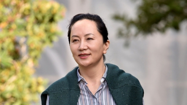 Huawei's Chief Financial Officer Meng Wanzhou leaves her Vancouver home to appear in British Columbia Supreme Court in Vancouver on September 25, 2019. [File Photo: VCG]