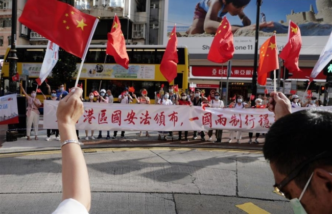 Hong Kong citizens celebrate the passage of the Law of the People's Republic of China on Safeguarding National Security in the Hong Kong Special Administrative Region (HKSAR) in Causeway Bay of south China's Hong Kong, June 30, 2020. [Photo: Xinhua]